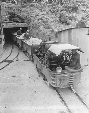Baby Gauge ore arriving from the widow Mine at Portal of Upper Biddy Tunnel - Courtesy National Park Service, Death Valley National Park